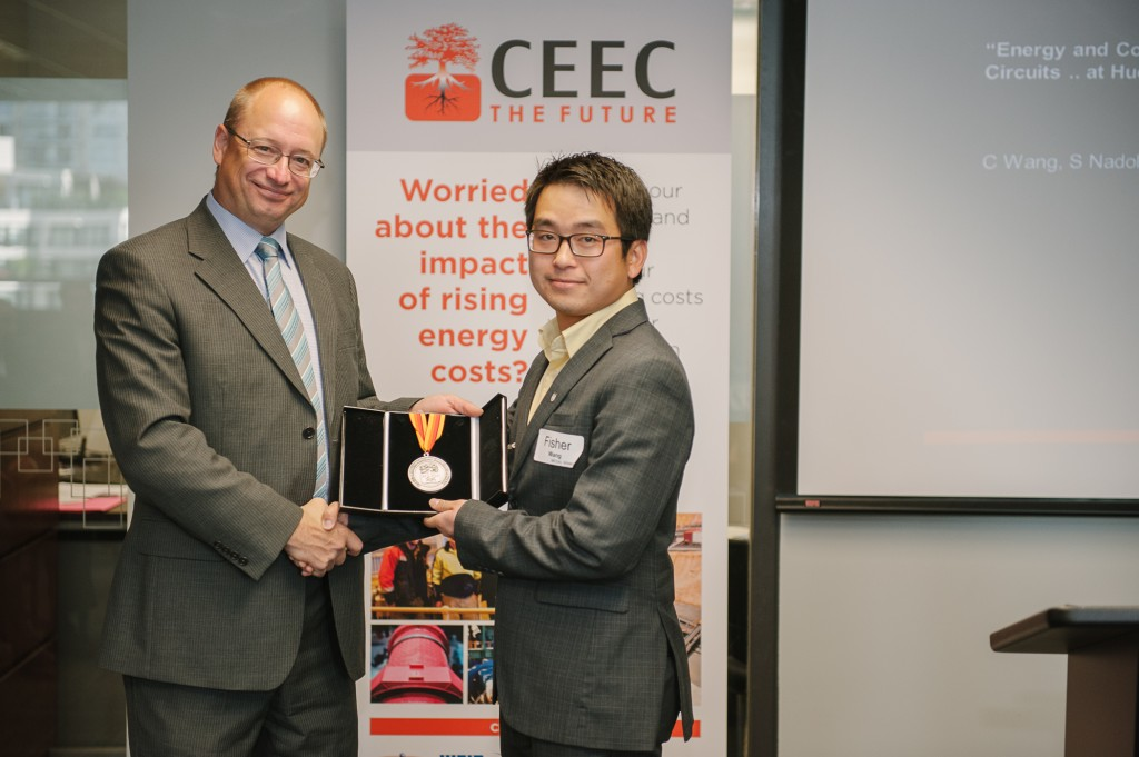 Fisher Wang receives his Medal from the Minister