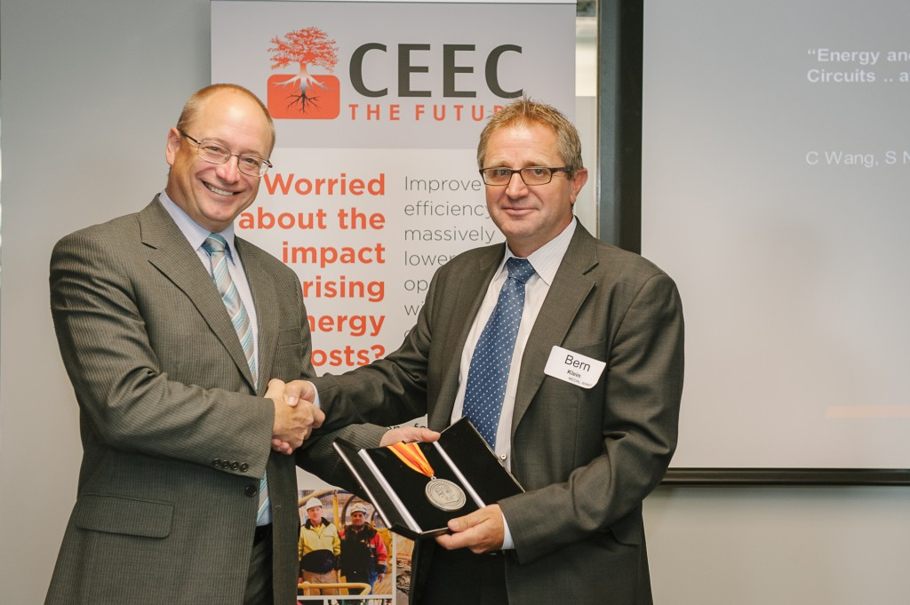 Prof Bern Klein receives his Medal from the Minister